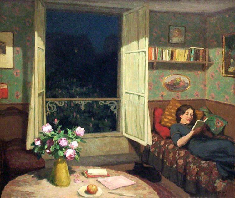 Tavik Simon Vilam reading books on a sofa